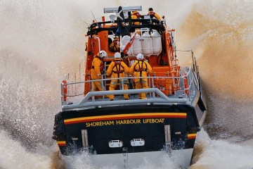 Shoreham Harbour Lifeboat 'Enid Collett' launched from boathouse for Exercise